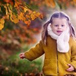 young girl in autumn themed photo shoot