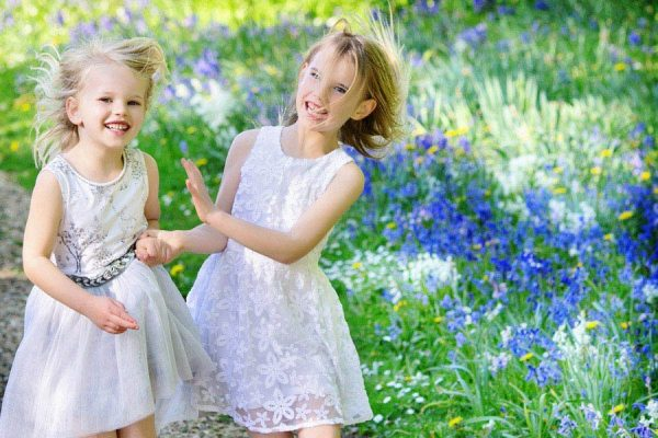Outdoor portrait of sisters in Bluebell woods