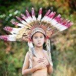 boy wearing Indian headdress in field children family photographer Nottingham
