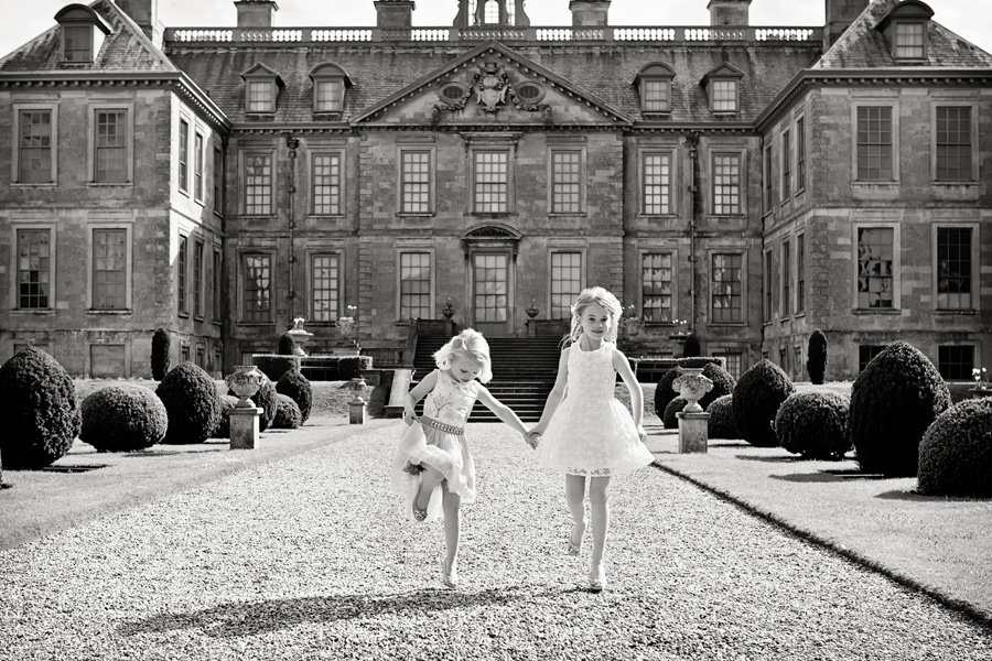 Sisters skipping at belton house family photography