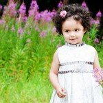 childrens-photographer-derby-portraits of young girl surrounded by flowers