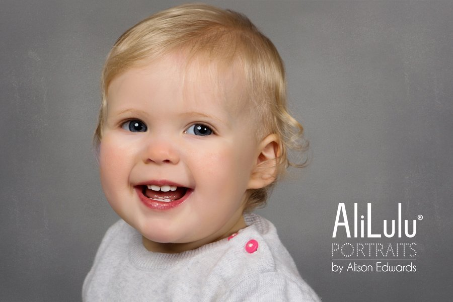 1 year old photo session of a baby girl smiling