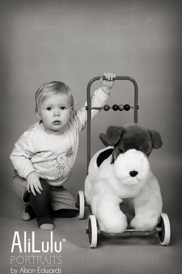 1 year old photo session of girl with her toy dog