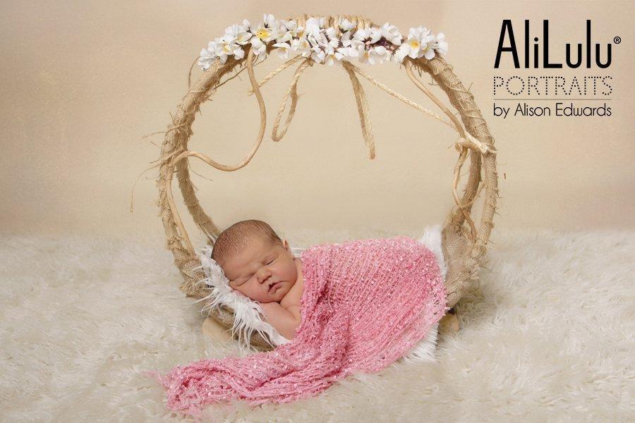 baby girl in hoop prop baby