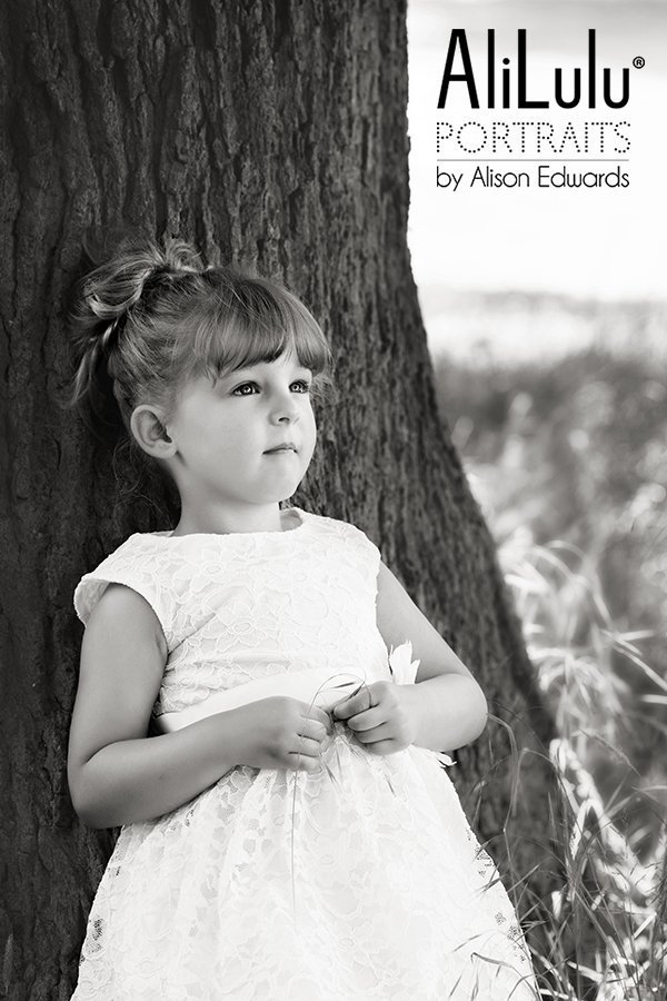 Girl leaning against trees by Portrait photographer Grantham