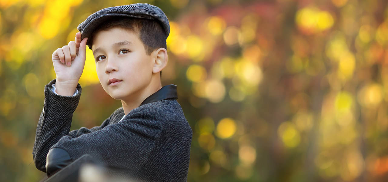 child photographer Nottingham autumn photo of boy wearing cap