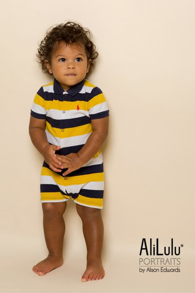 1 year old photo shoot Nottingham boy in navy and yellow stripped all in one