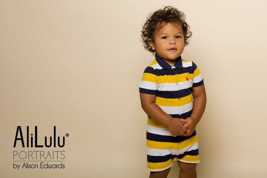 1 year old photo shoot boy wearing Ralph Lauren jumpsuit