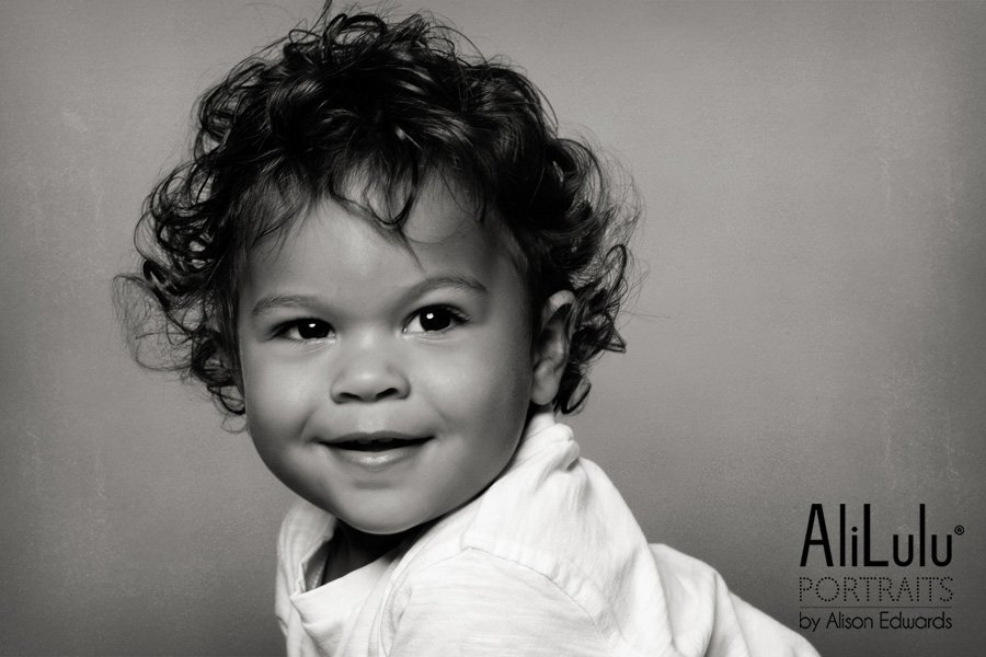 1 year old photo shoot Nottingham black and white studio portrait of boy smiling