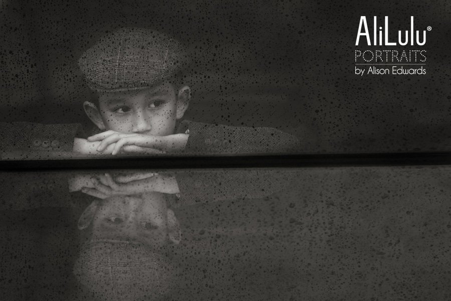 kids photos in the rain boy wearing flat cap looking through window