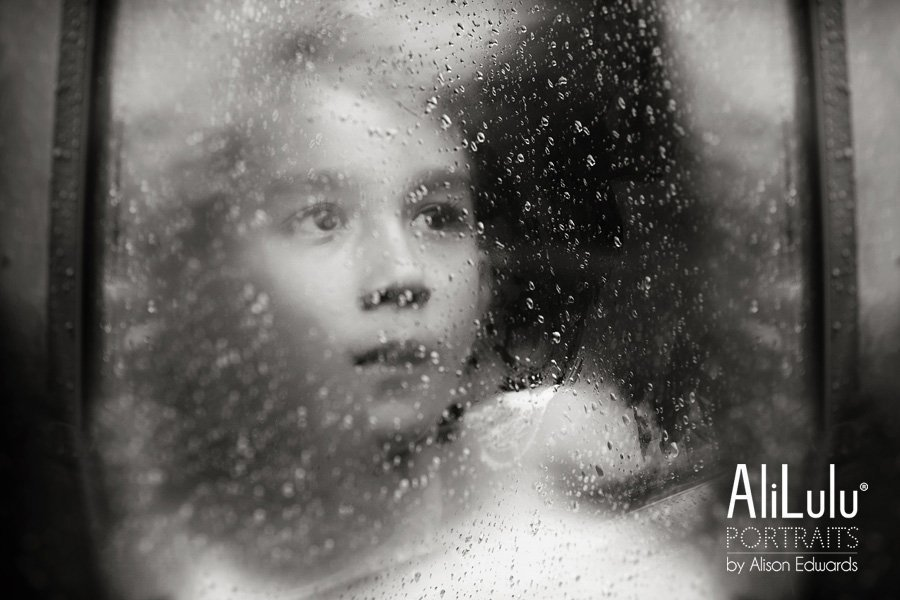 kids photos in rain with boy looking through window