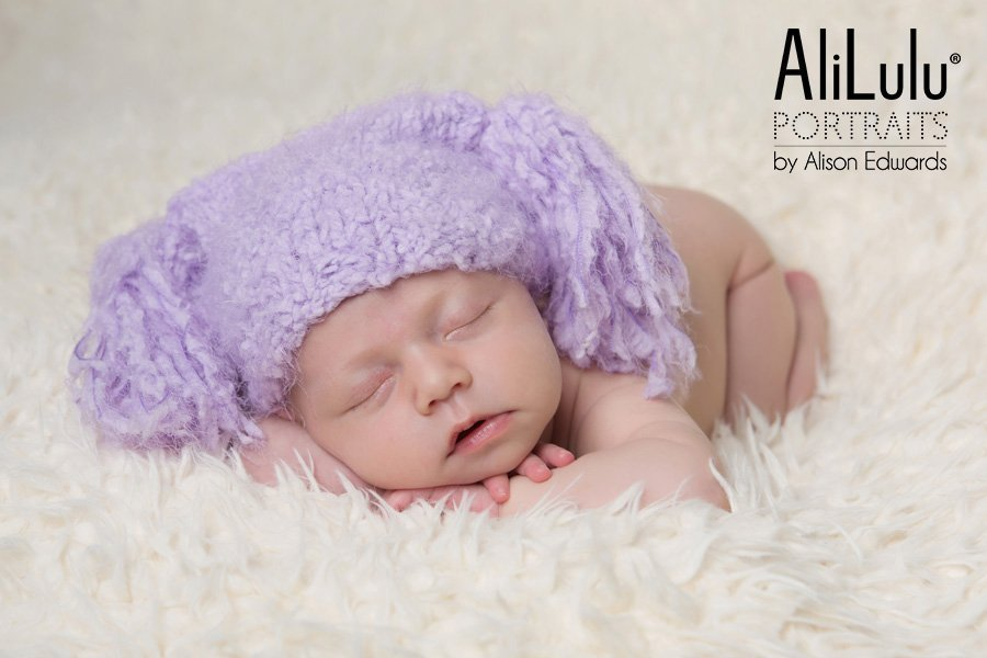 baby girl wearing lilac hat newborn baby photos Carlton