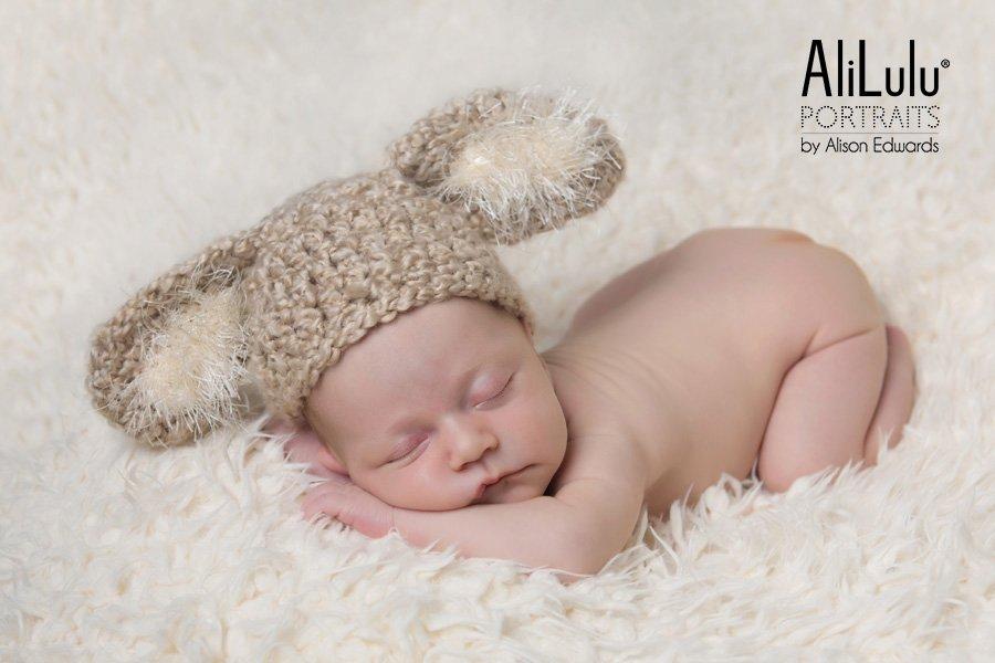 newborn baby photos baby girl wearing bunny ears hat