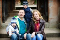 family of four sitting on steps at Rufford Abbey Nottingham