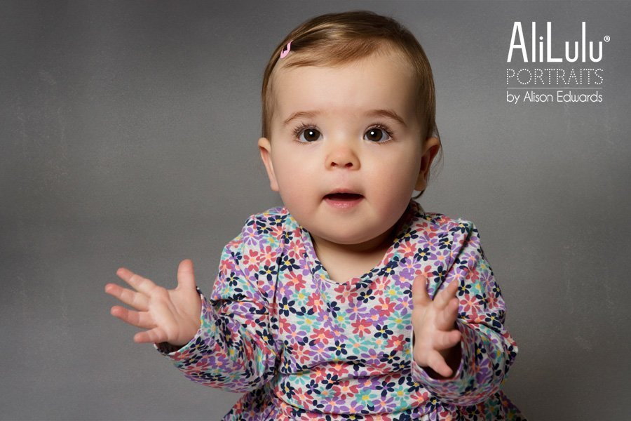 baby girl clapping at a photo shoot