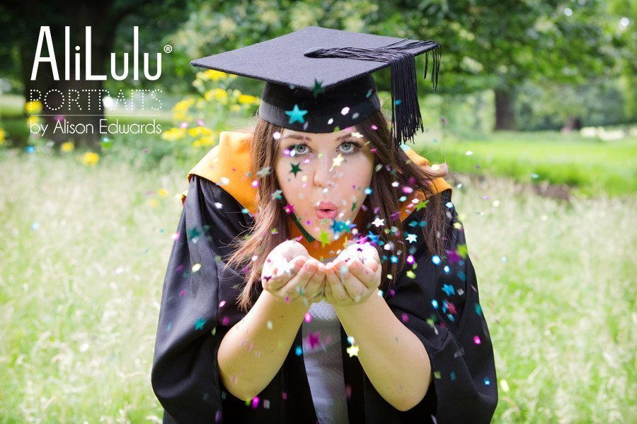 girl blowing confetti for graduation celebration