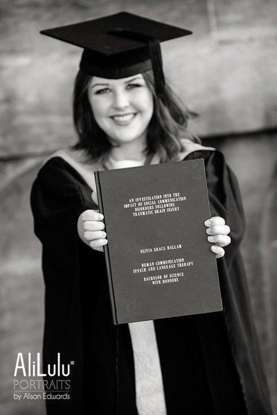 girl holding dissertation of Graduation in Nottingham