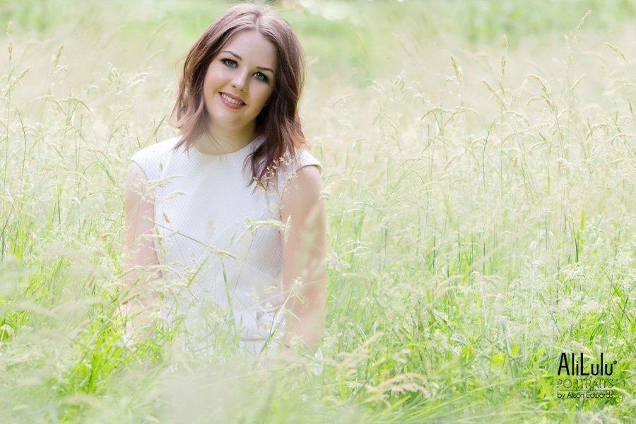 girl sitting in long grass