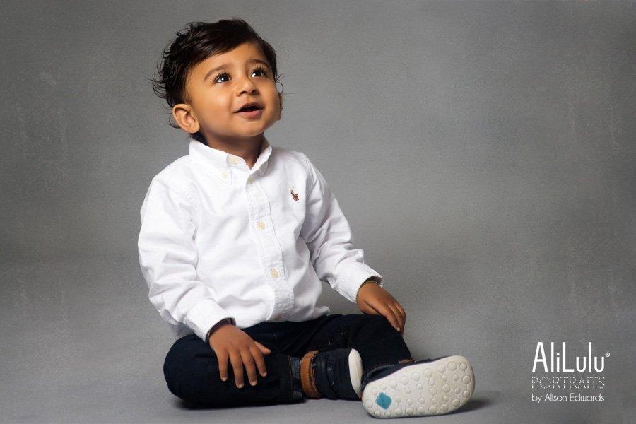 1 Year Old Boy Smiling Wearing White Shirt