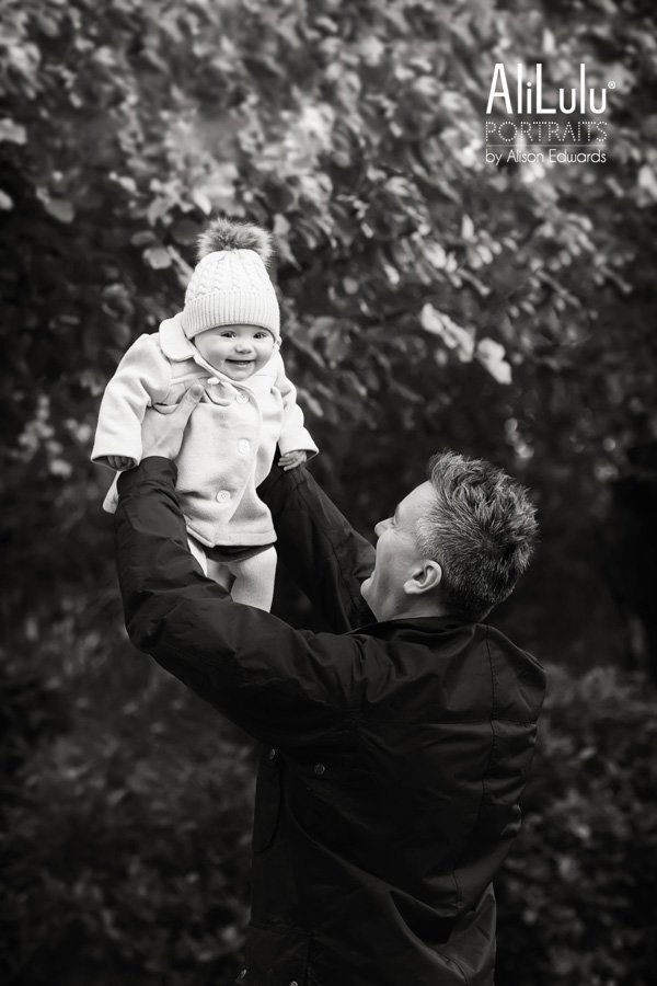 Nottingham family photographer captures dad throwing baby girl in air smiling