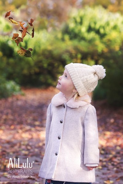 Nottingham family photographer girl watching autumn leaves fall
