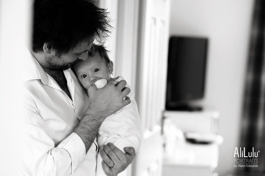 dad cuddling 3 month old baby