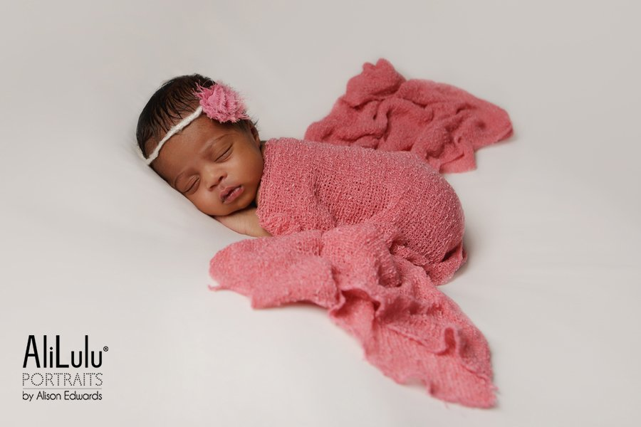 baby girl in pink wrap and headband