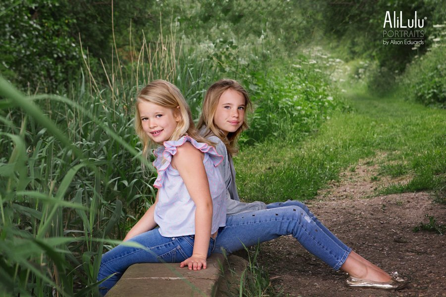 family photography Nottingham sisters sitting on pathway