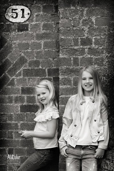 sisters leaning against wall nottingham