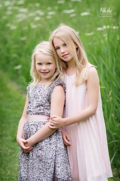 sisters in pretty dresses fields