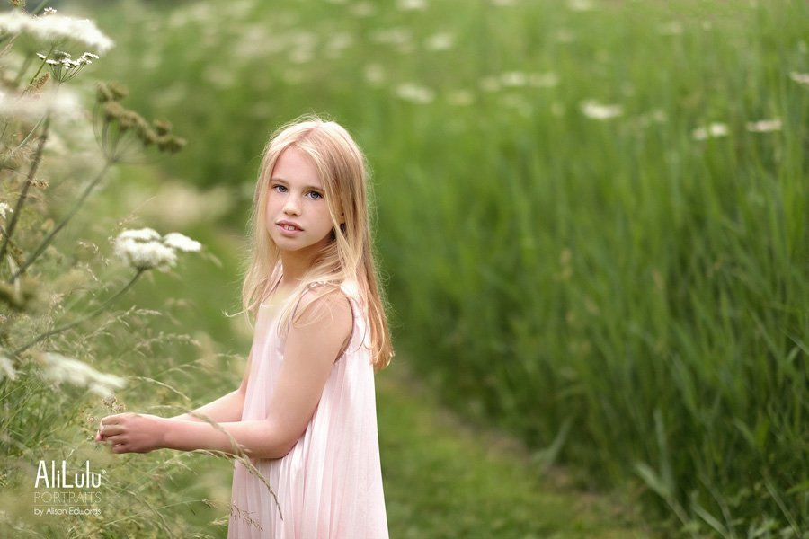 girl picking flowers in fields family photography Nottingham