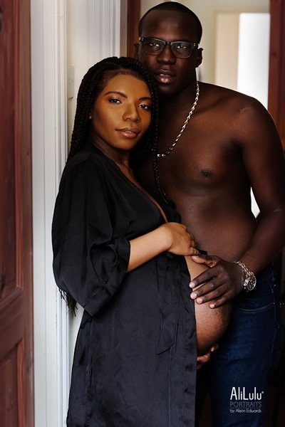 pregnant woman and partner maternity photos at home