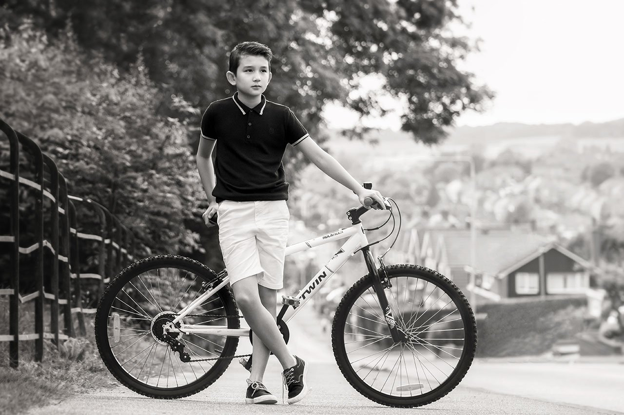 teen boy on bike on street
