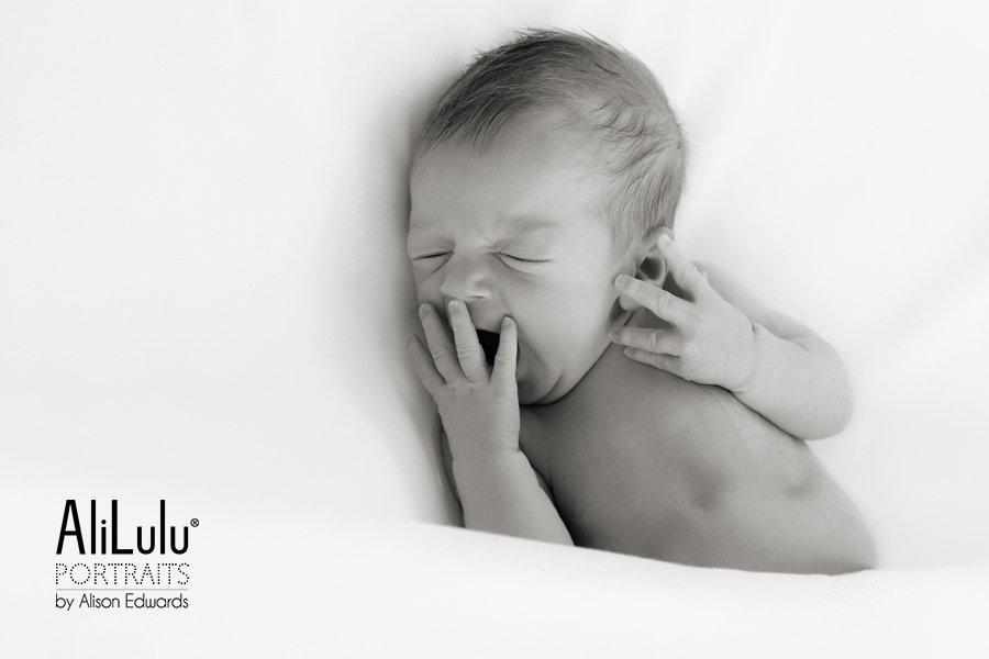 newborn phtotography at home baby yawning