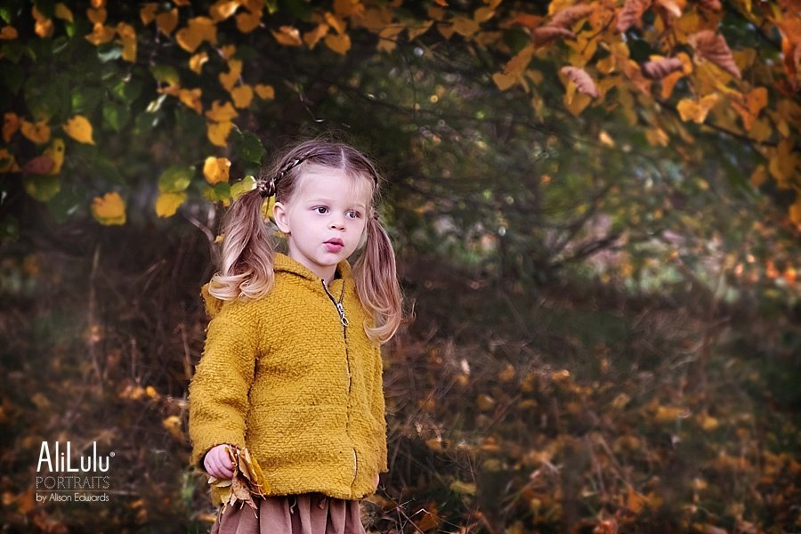 young girl in autumn theme photo shoot