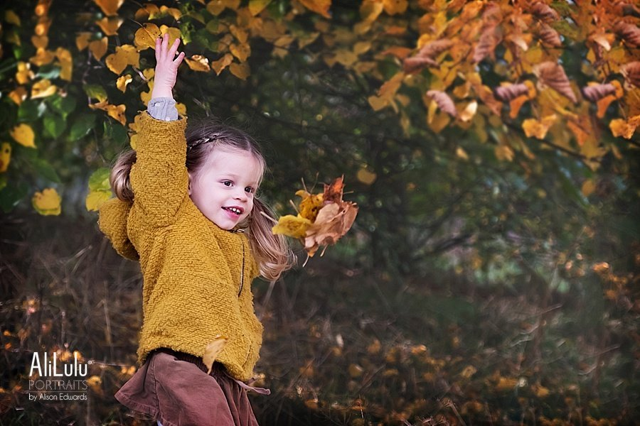 girl throwing leaves on autumn photo shoot Nottingham