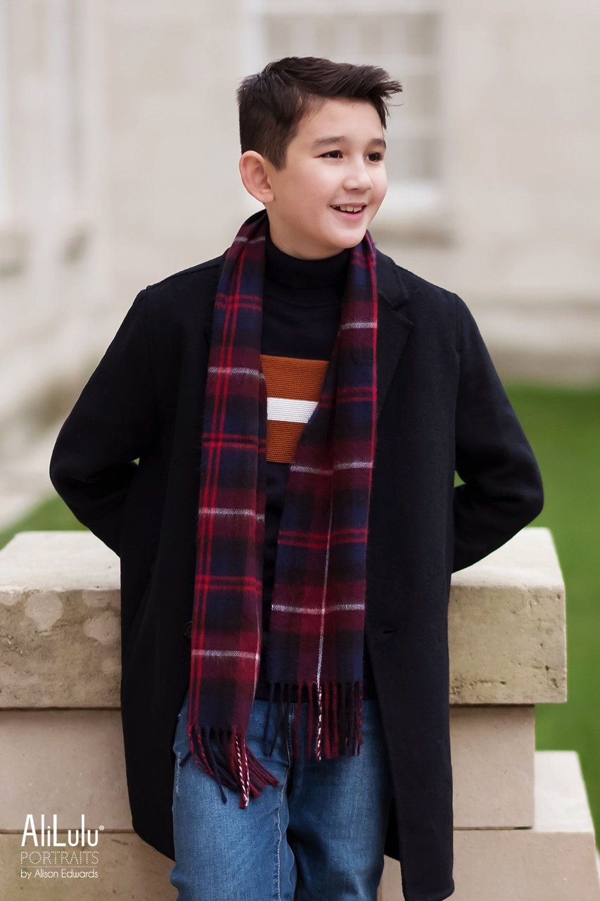 boy looking to side wearing zara coat and river island scarf jumper