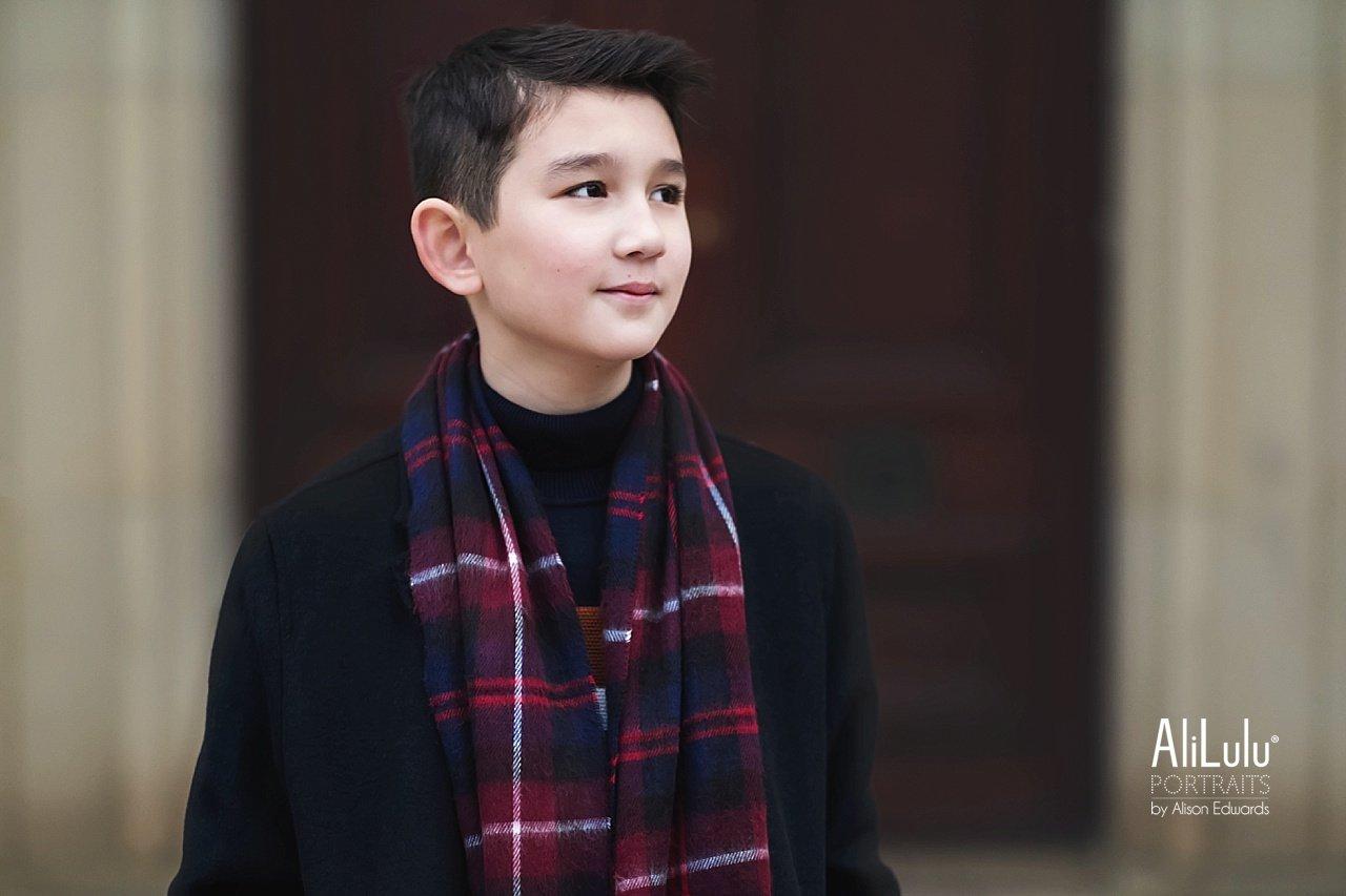Side profile of boy smiling brown eyes