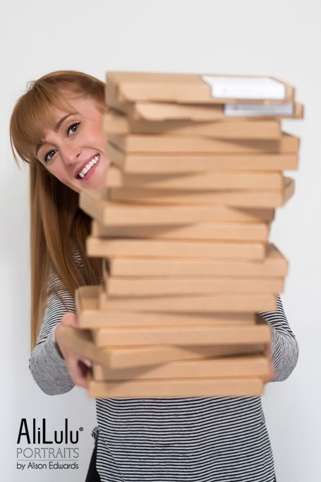 woman holding boxes on personal branding shoot nottingham