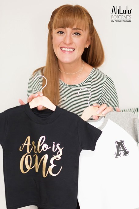 woman holding kids t-shirts on personal branding shoot