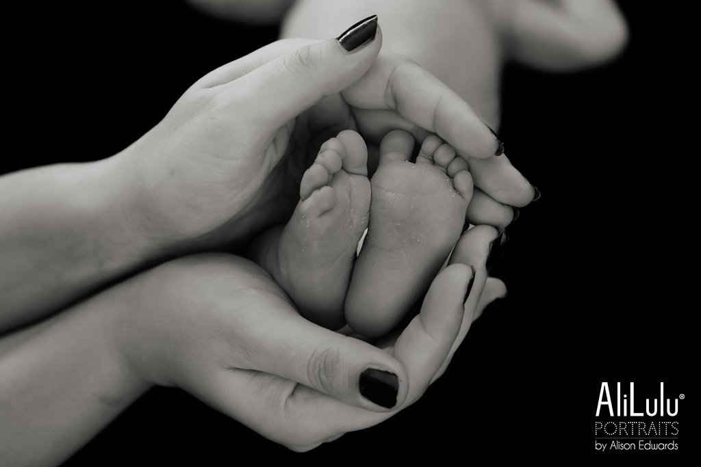 baby's feet in mum's hands
