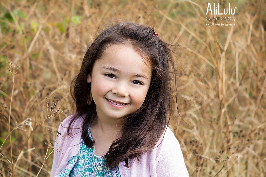 girl smiling in long grass