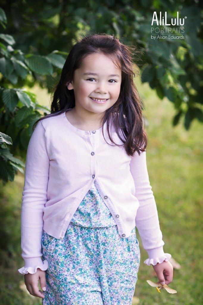 girl smiling wearing pink cardigan in Nottingham