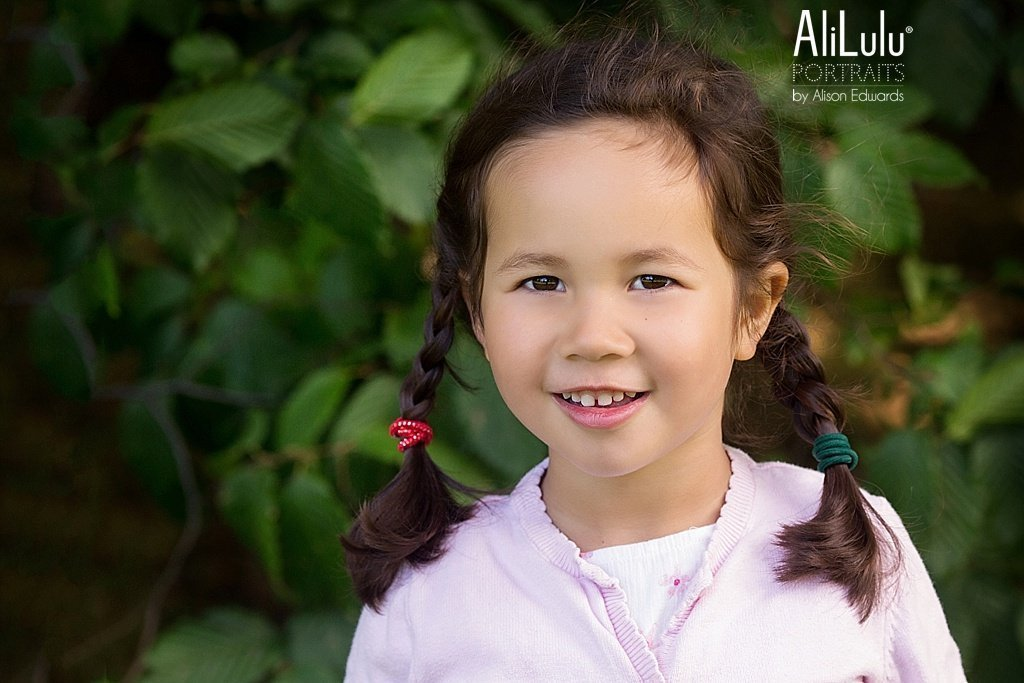 young girl in park smiling