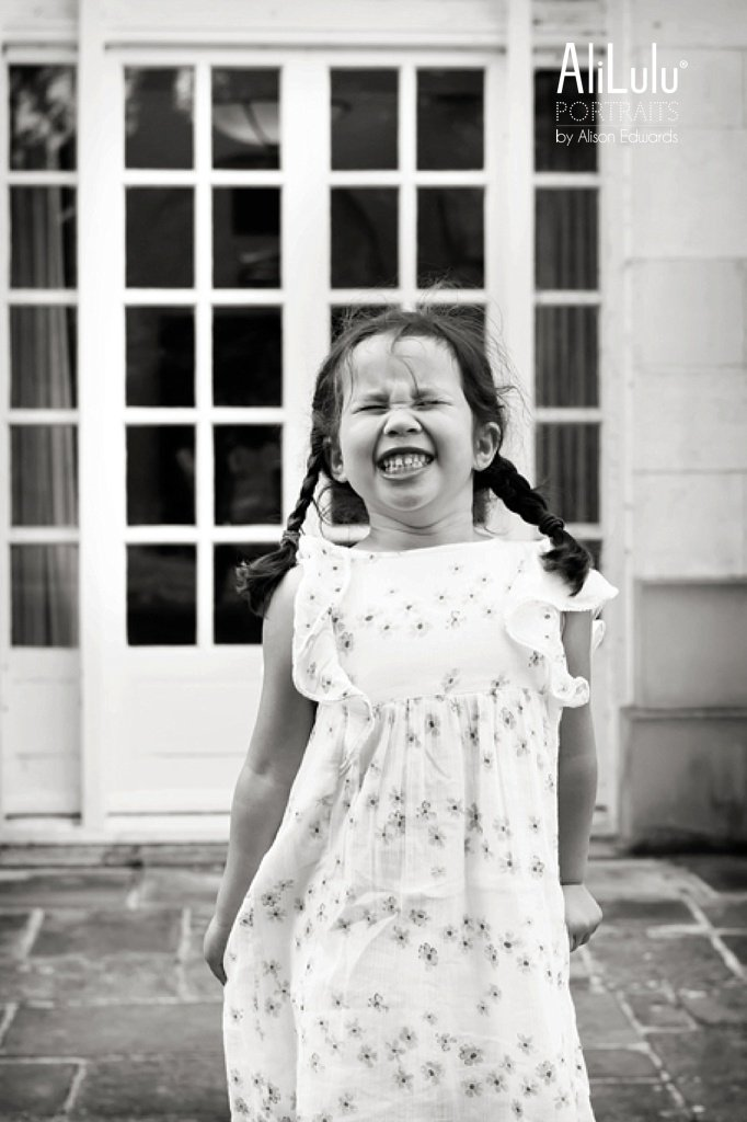 girl laughing and pulling a funny fa ce