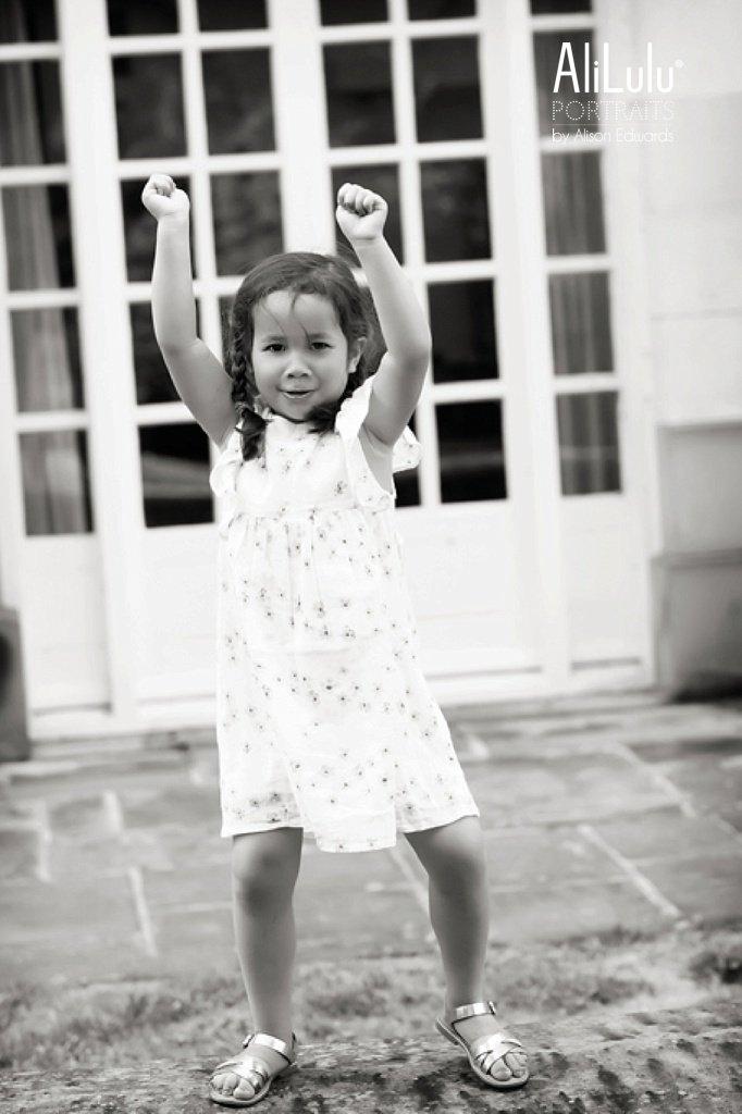 girl having fun dancing on wall