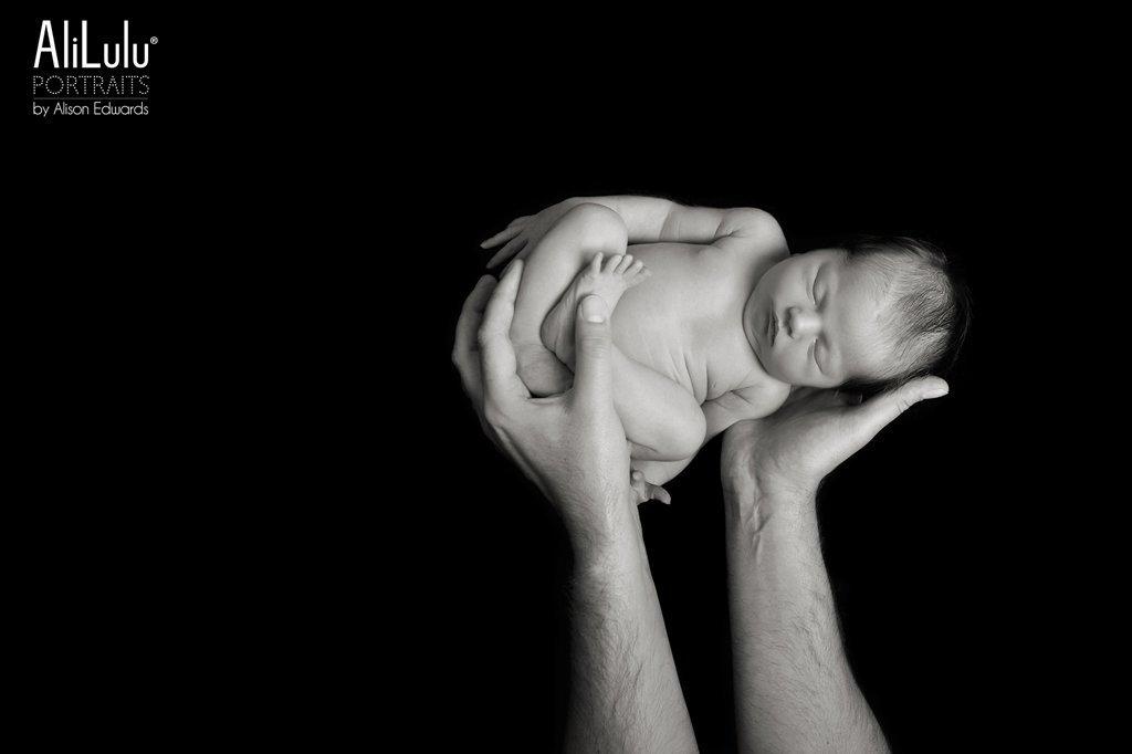 baby girl in dad's hands