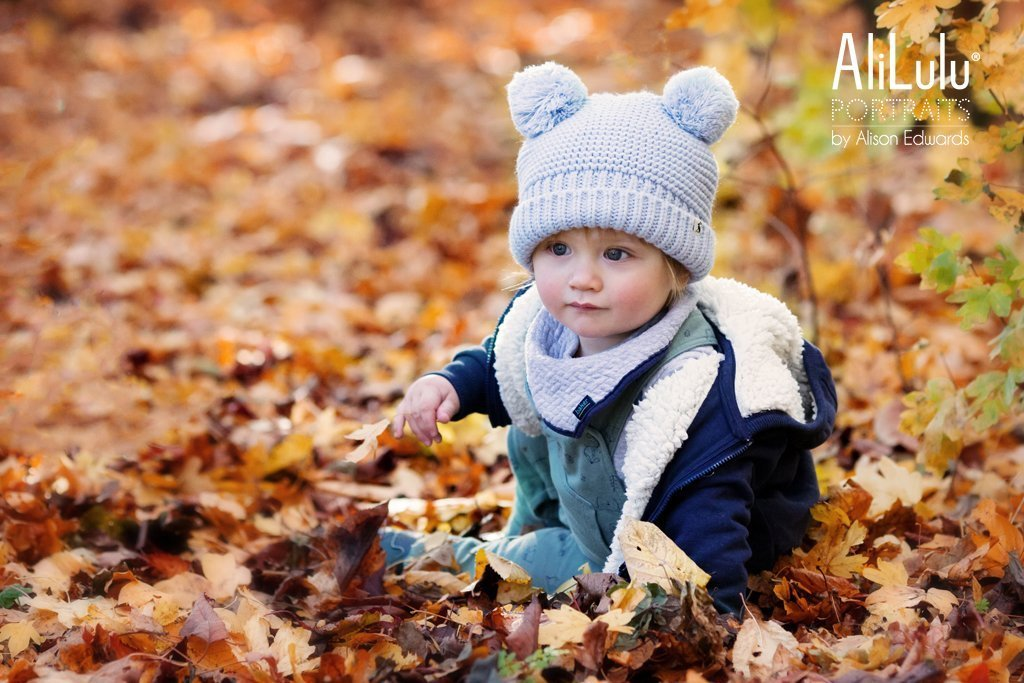 autumn photos in Nottingham boy sitting in leaves