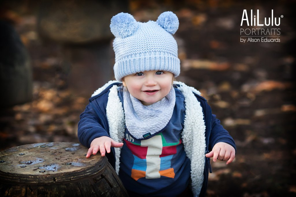 boy wearing cue hat in autumn photo shoot Nottingham