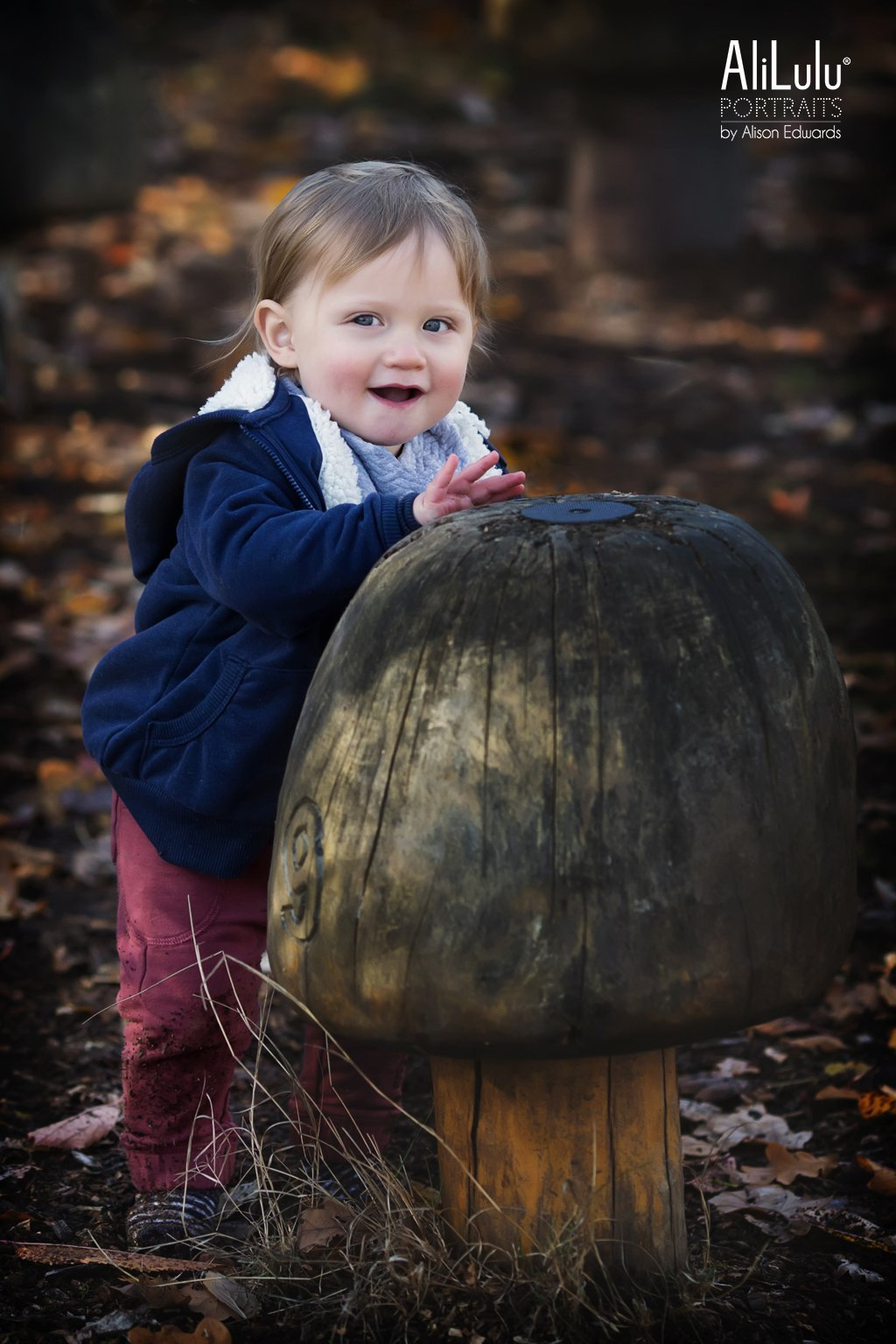 boy laughing in autumn photo shoot Nottingham
